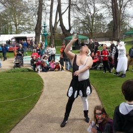 A fire-eating circus performer entertains the crowd, battling the blustery winds!