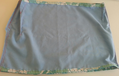 Inside out, to show lining.
