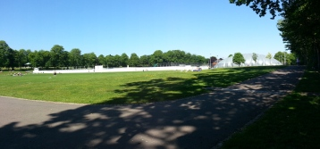 The all-weather tennis courts, under the 'bubble' beside the cricket pitch.