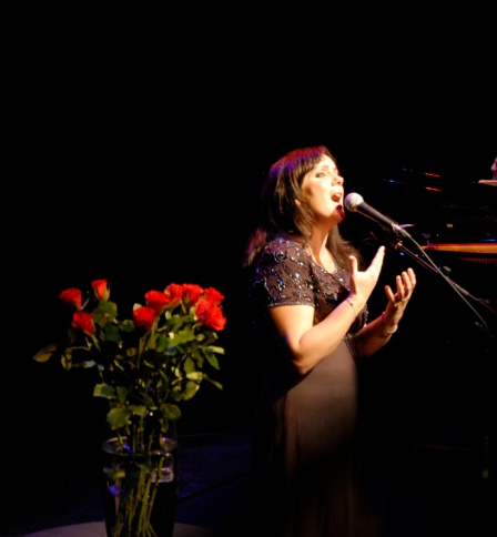 Christine, performing the songs of Edith Piaf.