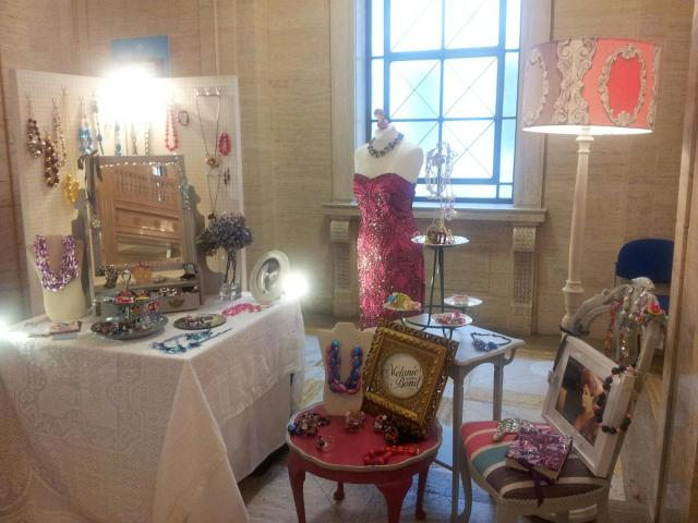 Melanie's stall at the Unify Fashion Showcase.  Furniture: Jenny Bond Interiors, mannequin: Anne Louise Designs, vintage dress: Unique Boutique.