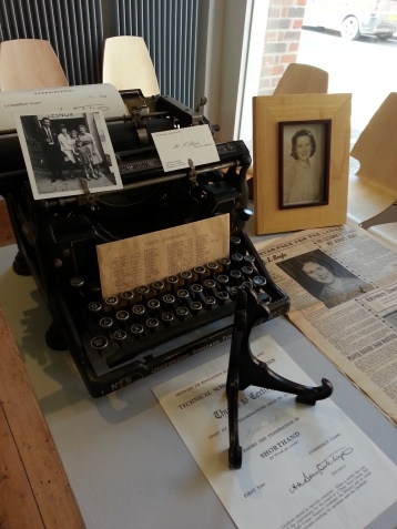 Anthea's mother's old typewriter and shorthand certificates.
