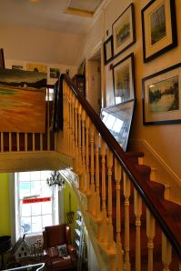 The inviting staircase that leads to Top Floor Art